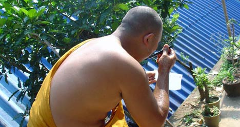 buddhist monk shaving